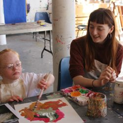 Volunteer Corah Ambrose with young artist