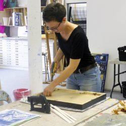 Volunteer Hana Wilde printing