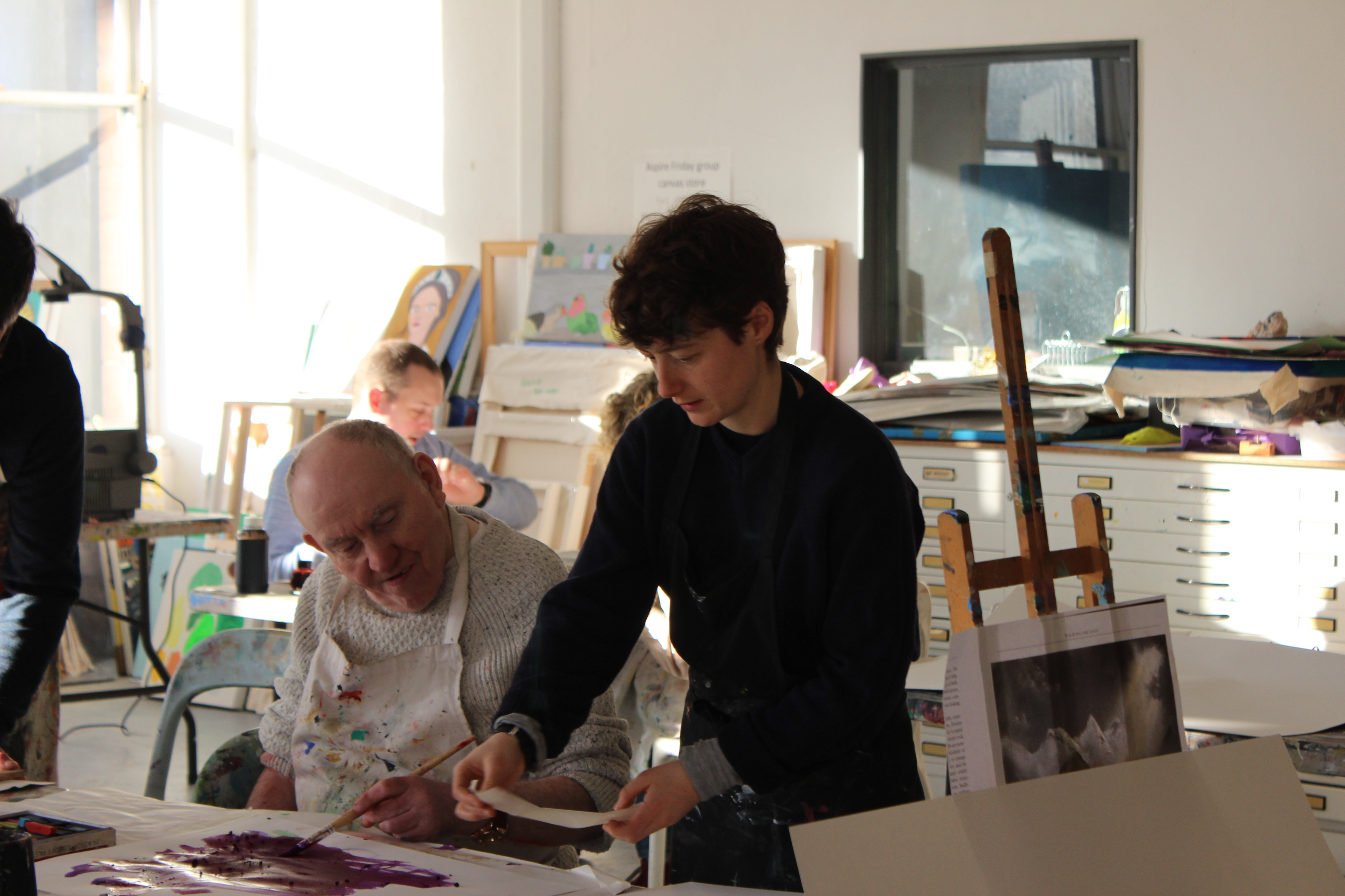 volunteer with artist at project ability art class