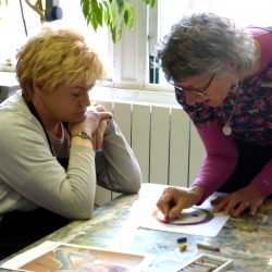 volunteer helping an artist at Project Ability