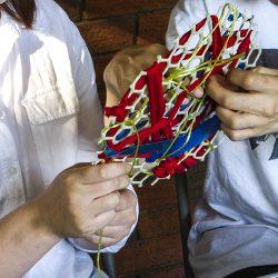 Accessible handmade woven art hanging at Linn Park