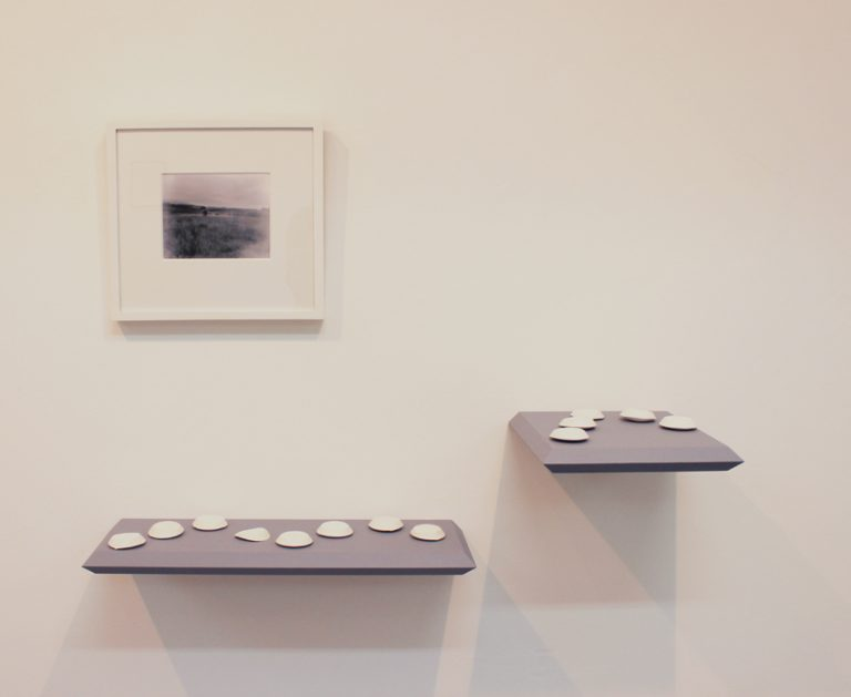 Simon McAuley's Pin hole photograph framed and on a gallery wall amongst other work.