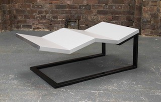 White zig zag sculpture with black frame called by 'kitchen Cantilever'