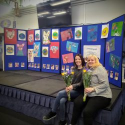 Art tutor Tracy and Aspire Artist Doreen collecting flowers as a thank you at Abercorn School