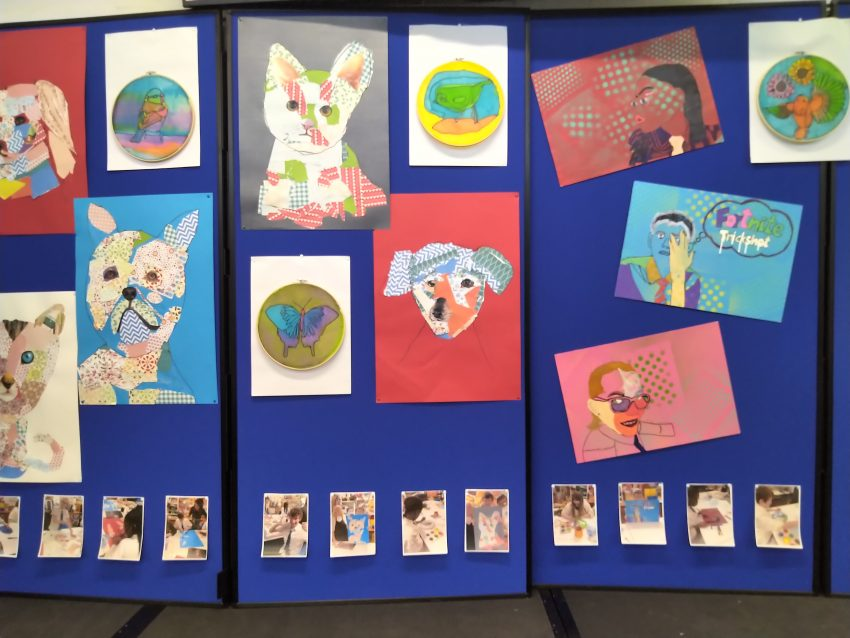 art work hanging on blue boards at Abercorn School.