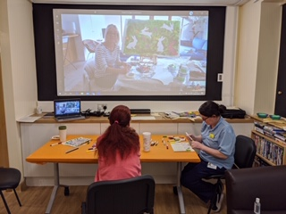 video conferencing call at an outreach art workshop