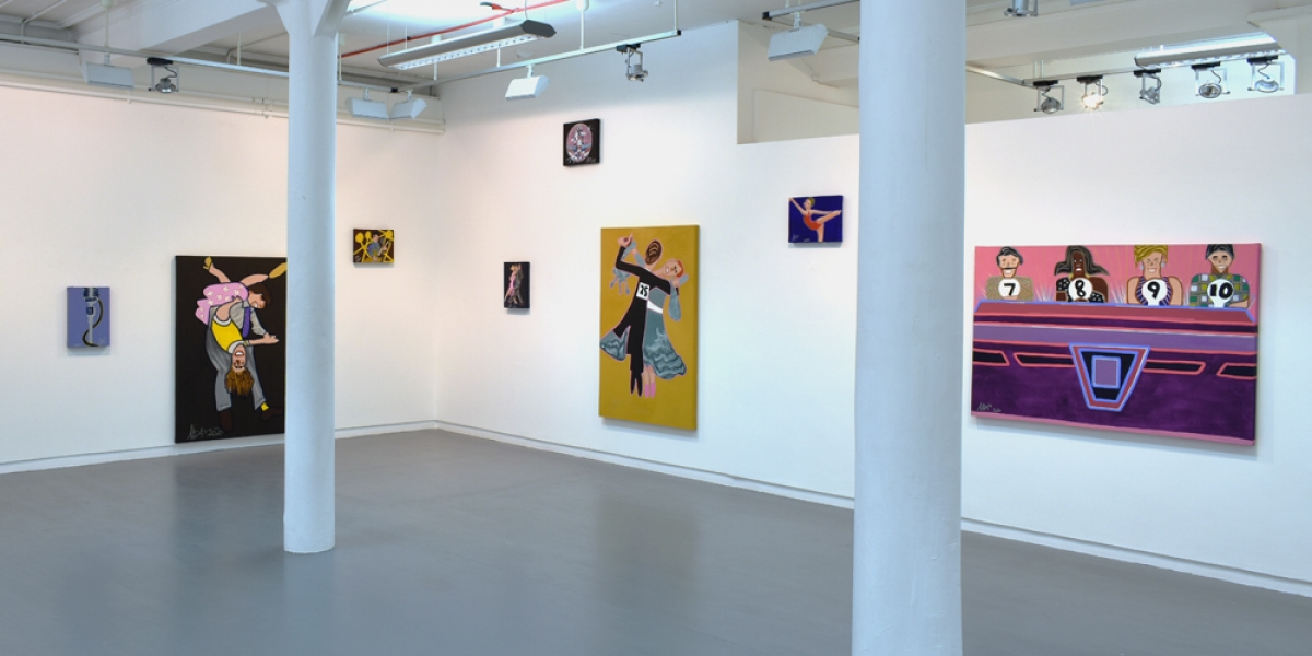 The Project Ability gallery. White walls adorned with big vibrant canvases. Two show couples dancing, and another shows the judging panel on Strictly Come Dancing. There are smaller canvases scattered around, showing solo dancers, a microphone and a disco ball.